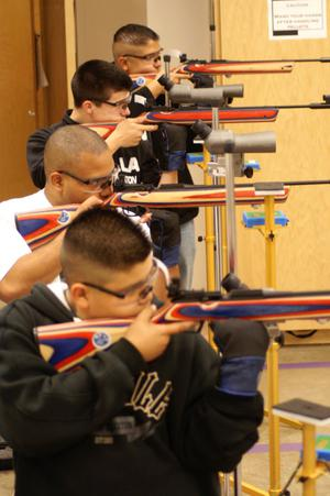 Primary view of object titled '[Air Rifle Team members practice for a tournament]'.