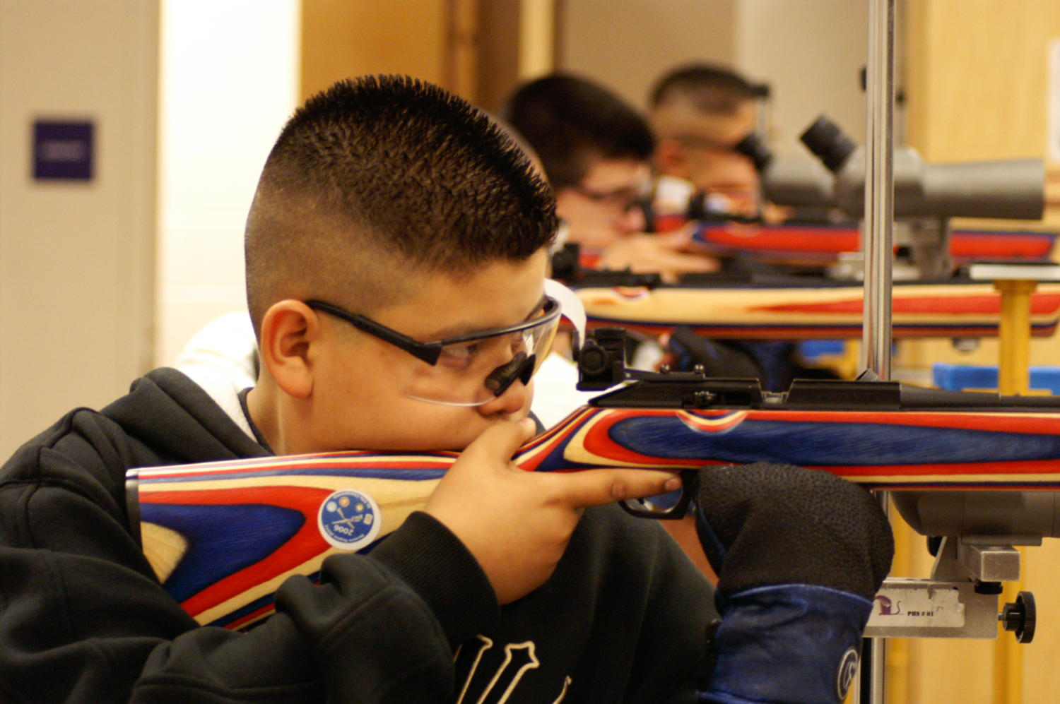 [Air Rifle Team line up for practice]                                                                                                      [Sequence #]: 1 of 1