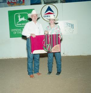 Primary view of object titled '[Allison Bailey and man in Youth division award presentation at Will Rogers Coliseum]'.