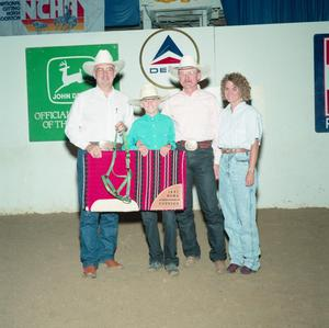 Primary view of object titled '[Bob Welch and three adults in Youth division award presentation at Will Rogers Coliseum]'.