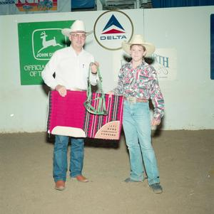 Primary view of object titled '[Buck Frazier and man in Youth division award presentation at Will Rogers Coliseum]'.