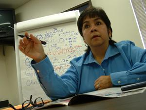 Primary view of object titled '[Elizabeth Lopez pointing with pen in right hand]'.
