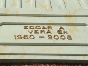 Primary view of object titled '[Close-up of name and date on Edgar Vera's casket]'.