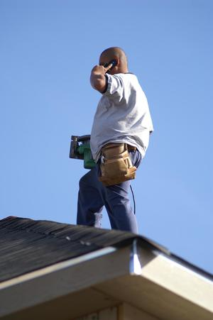 Primary view of object titled '[Man on roof talking on cellular phone]'.