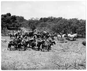 [Photograph of a Group on Horseback]