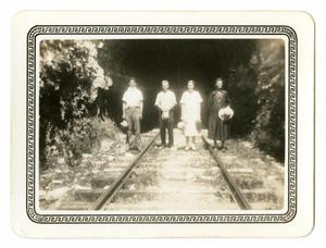 Primary view of object titled '[Photograph of a Group of People on a Railroad Track]'.