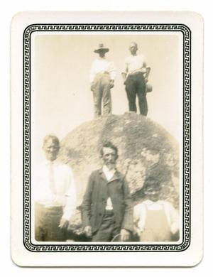 Primary view of object titled '[Photograph of a Group by a Rock]'.