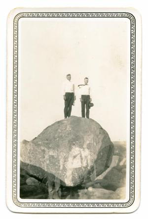 Primary view of object titled '[Photograph of Two Men Standing on a Rock]'.