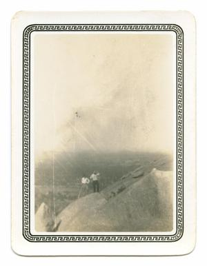 Primary view of object titled '[Photograph of Two Men Standing on a Boulder]'.