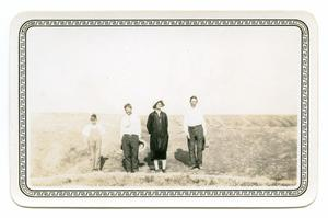 Primary view of object titled '[Photograph of a Boy, two Men, and a Woman]'.