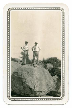 Primary view of object titled '[Photograph of Two Men Standing on Balanced Rock]'.