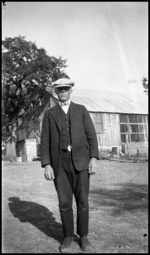Primary view of object titled '[Photograph of a Man Standing Outside]'.