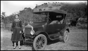 Primary view of object titled '[Photograph of a Woman by an Automobile]'.
