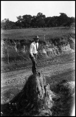 Primary view of object titled '[Photograph of a Man Standing on a Rock]'.