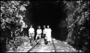 [Photograph of a Group of People on a Railroad Track]