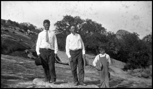 Primary view of object titled '[Photograph of Two Men and a Young Boy Outside]'.