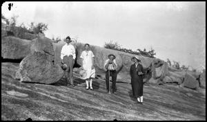 [Photograph of a Group of Four People Outside]