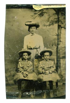 Primary view of object titled '[Tintype Portrait of a Woman and Two Girls]'.