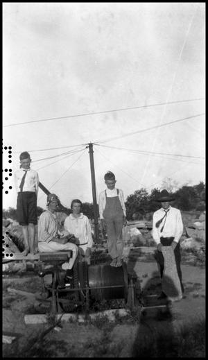 Primary view of object titled '[Photograph of a Family on a Crane at a Granite Quarry]'.