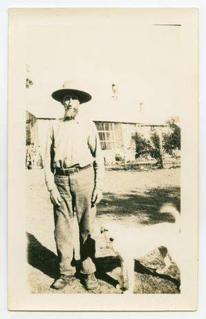 Primary view of object titled '[Photograph of Gus Jentsch and a Dog]'.