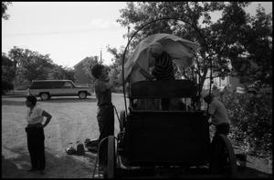 Primary view of object titled '[Photograph of People Setting up a Float]'.