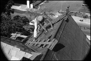 Primary view of object titled '[Photograph of a Worker on a Roof]'.
