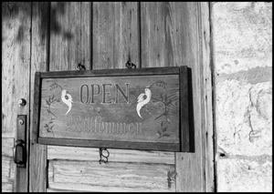 Primary view of object titled '[Photograph of a Sign for Willkommen in Fredericksburg]'.
