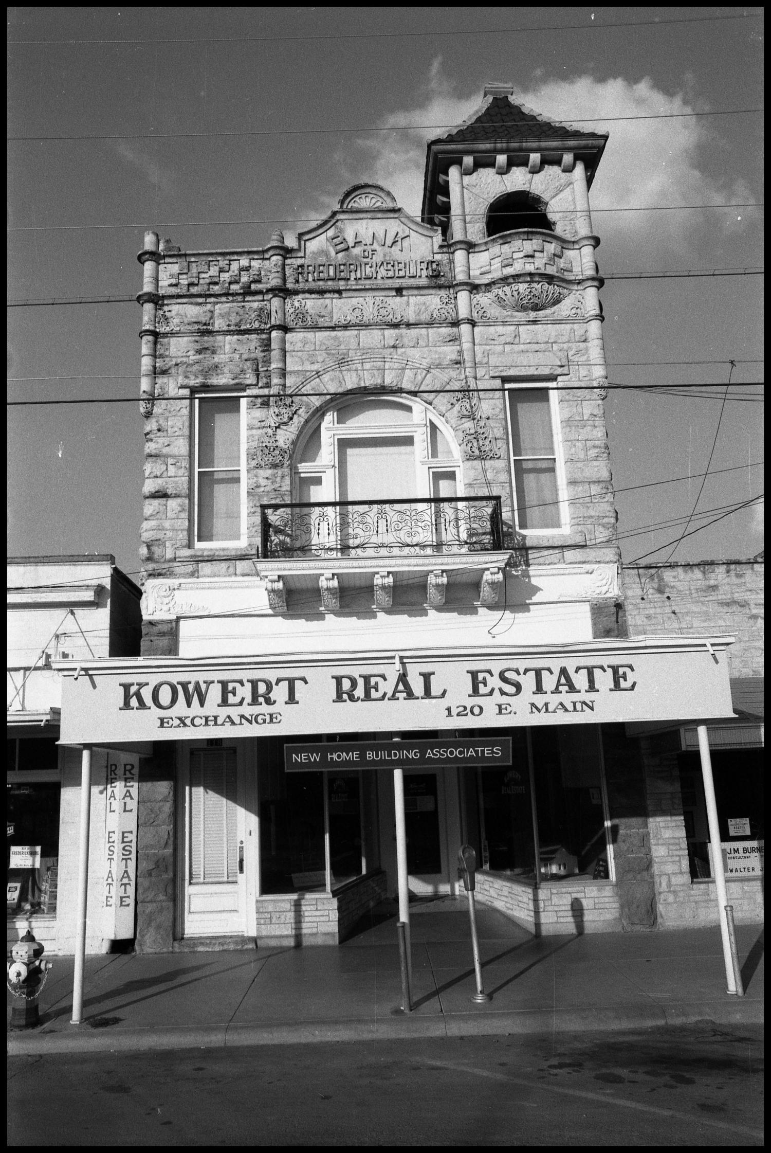 [Photograph of Kowert Real Estate]                                                                                                      [Sequence #]: 1 of 1