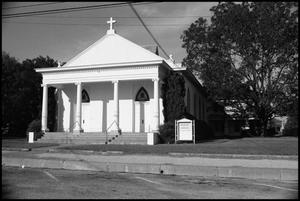 Primary view of object titled '[Photograph of a Church with Senior Center Sign]'.
