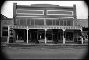 Primary view of object titled '[Photograph of a Store in Fredericksburg]'.