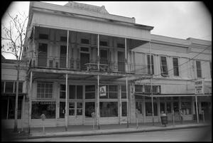Primary view of object titled '[Photograph of Two Businesses in Fredericksburg]'.