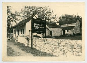 Primary view of object titled '[Entrance at Gillespie County's Pioneer Museum]'.
