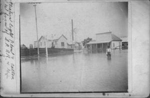 Primary view of object titled '[African American boy knee-deep in water during 1899 flood]'.
