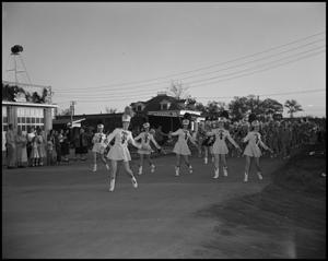 Primary view of object titled '[Marching Band and Twirlers in Santa Parade]'.