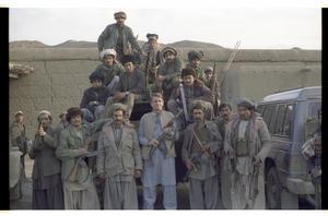 Primary view of object titled '[Charles Wilson Poses with Armed Mujahideen]'.