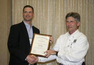 Primary view of object titled '[Craig Bonds accepts award at the 2012 annual meeting banquet]'.