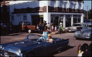 Primary view of object titled '[Photograph of Cars in a Palestine, Texas Parade]'.