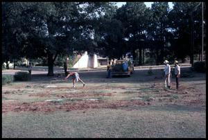 Primary view of object titled '[Workers Clean up Park Area]'.