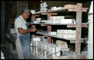 Primary view of object titled '[Unidentified Man beside Product Made by Palestine Tile Factory]'.