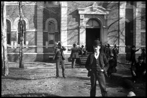 Primary view of object titled '[Unidentified Men Outside Third Anderson County Courthouse]'.