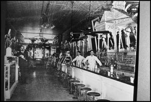Primary view of object titled '[Interior of a Brattons Drug Store]'.
