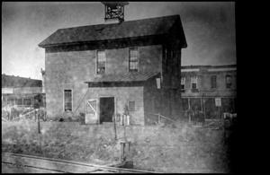 Primary view of object titled '[Side view Firehouse #1, Palestine Fire Department]'.