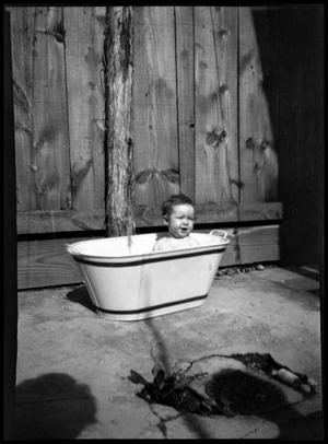 Primary view of object titled '[Unidentified Child in Washtub]'.