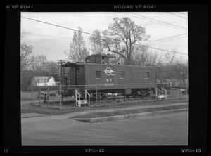 Primary view of object titled '[Caboose at Reagan School]'.