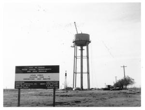 Primary view of object titled '[Water tower construction with site sign]'.