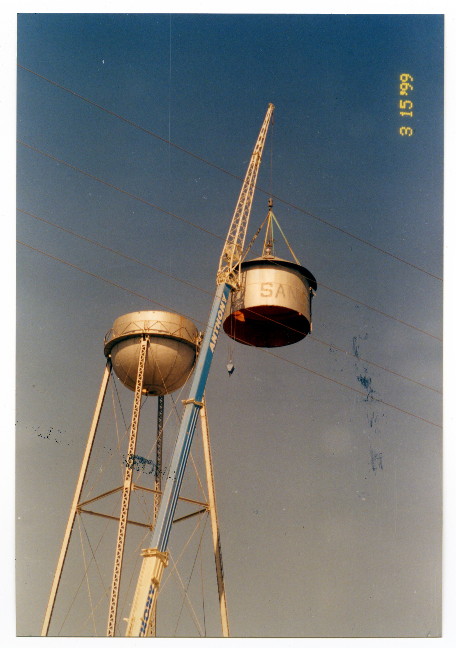 [Dismantling old water tower, removing the top]                                                                                                      [Sequence #]: 1 of 2