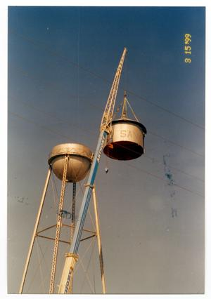 Primary view of object titled '[Dismantling old water tower, removing the top]'.