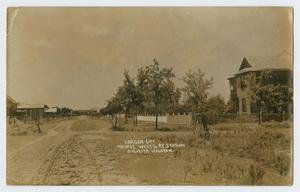Primary view of object titled '[Postcard of Main Street in League City]'.