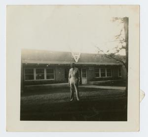 Primary view of object titled '[Joseph Kilgore in Front of a U.S.O. Building]'.
