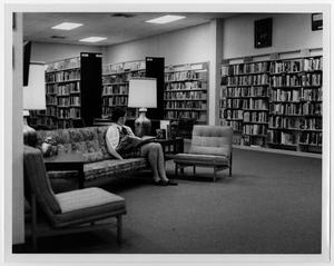 Primary view of object titled '[Visitor Reading at Helen Hall Library]'.